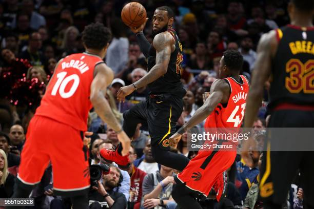LeBron James of the Cleveland Cavaliers looks to pass around Pascal Siakam of the Toronto Raptors during the second half of Game Three of the Eastern...