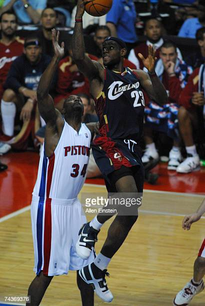 LeBron James of the Cleveland Cavaliers looks to try a layup backwards against Dale Davis of the Detroit Pistons in Game Five of the Eastern...