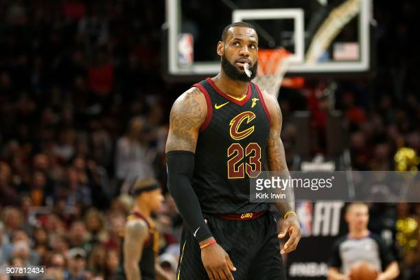 LeBron James of the Cleveland Cavaliers looks up at the scoreboard during a stoppage in play in the second quarter of the game against the Oklahoma...