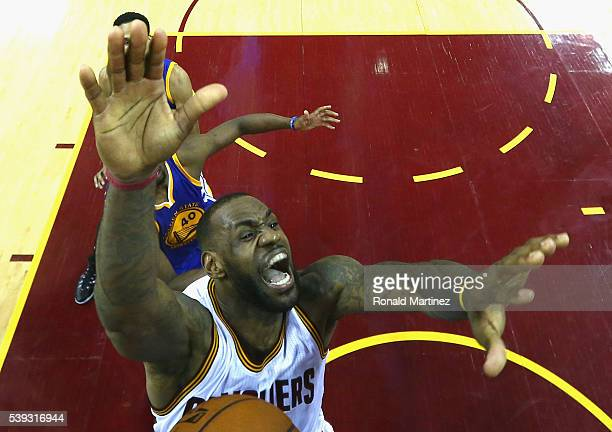 LeBron James of the Cleveland Cavaliers loses control of the ball at the hoop during the second half against the Golden State Warriors in Game 4 of...