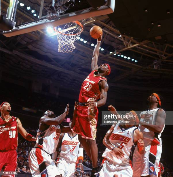 LeBron James of the Cleveland Cavaliers makes a dunk against the Charlotte Bobcats at Charlotte Coliseum on November 18, 2004 in Charlotte, North...