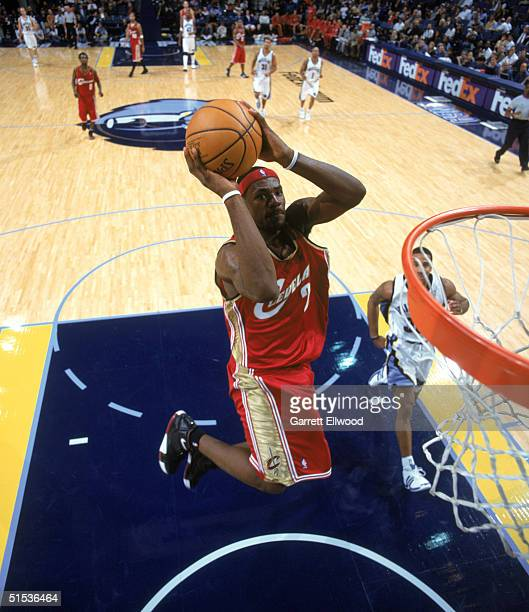 LeBron James of the Cleveland Cavaliers makes a dunk during a preseason game against the Memphis Grizzlies at FEDEX Forum on October 14 2004 in...