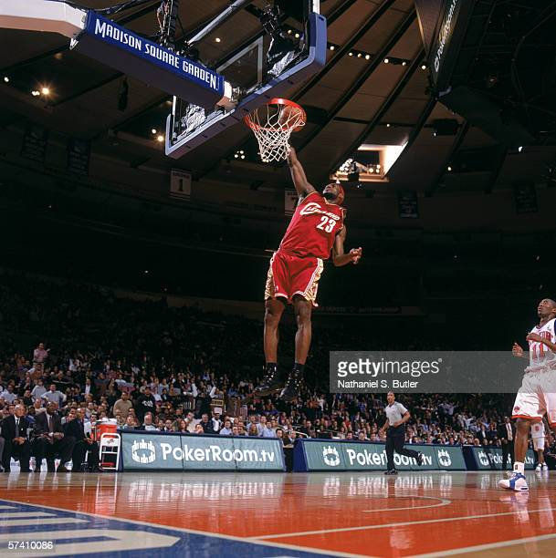 LeBron James of the Cleveland Cavaliers makes a dunk during the game against the New York Knicks at Madison Square Garden on April 5, 2006 in New...