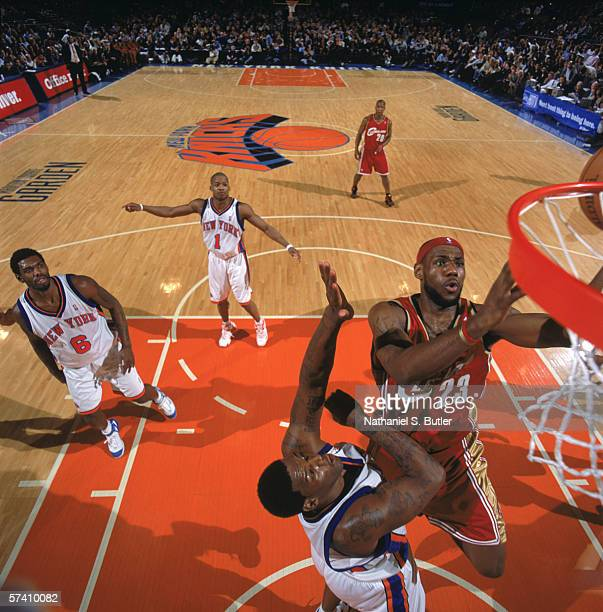 LeBron James of the Cleveland Cavaliers makes a layup against Eddy Curry of the New York Knicks at Madison Square Garden on April 5, 2006 in New...