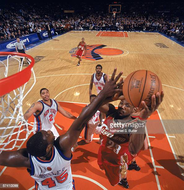 LeBron James of the Cleveland Cavaliers makes a layup against Jackie Butler of the New York Knicks at Madison Square Garden on April 5, 2006 in New...