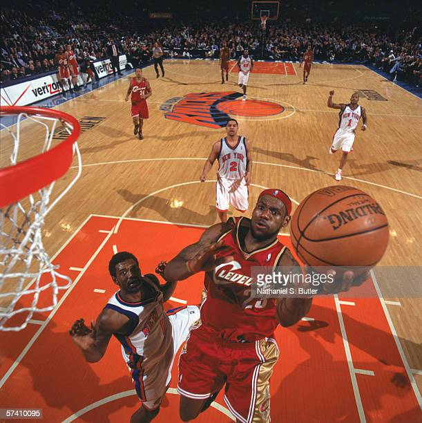 LeBron James of the Cleveland Cavaliers makes a layup during the game against Qyntel Woods of the New York Knicks at Madison Square Garden on April 5...
