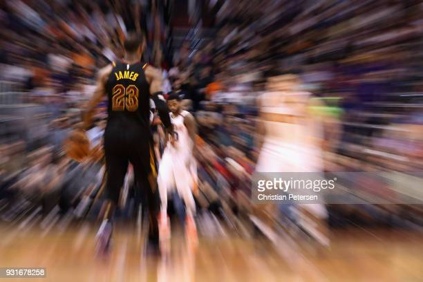 LeBron James of the Cleveland Cavaliers moves the ball down court during the second half of the NBA game against the Phoenix Suns at Talking Stick...