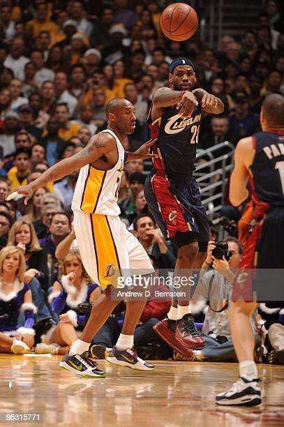 LeBron James of the Cleveland Cavaliers passes against Kobe Bryant of the Los Angeles Lakers at Staples Center on December 25 2009 in Los Angeles...