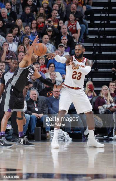 LeBron James of the Cleveland Cavaliers passes against Vince Carter of the Sacramento Kings on December 27 2017 at Golden 1 Center in Sacramento...