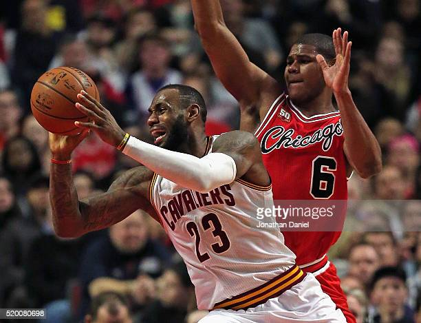 LeBron James of the Cleveland Cavaliers passes as he moves past Cristiano Felicio of the Chicago Bulls at the United Center on April 9, 2016 in...