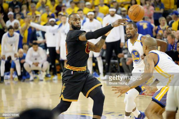 LeBron James of the Cleveland Cavaliers passes the ball against the Golden State Warriors in Game Five of the 2017 NBA Finals on June 12 2017 at...