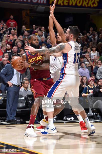 LeBron James of the Cleveland Cavaliers passes the ball against the Philadelphia 76ers on December 9 2017 at Quicken Loans Arena in Cleveland Ohio...
