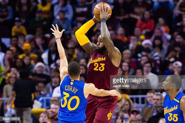 LeBron James of the Cleveland Cavaliers passes while under pressure from Stephen Curry of the Golden State Warriors during the first half at Quicken...