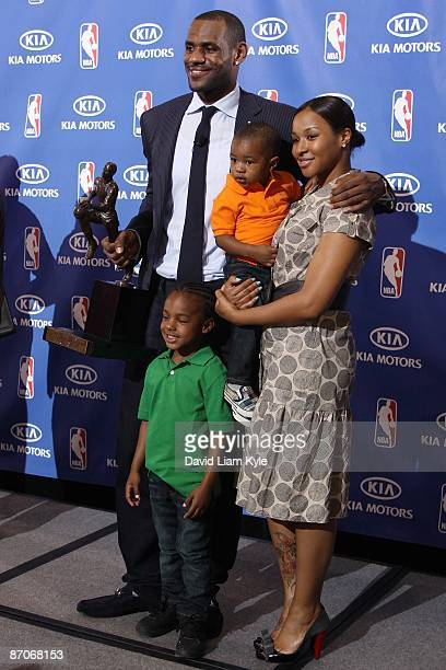 LeBron James of the Cleveland Cavaliers poses for a photo with sons LeBron Jr and Bryce and their mother Savannah Brinson after he was named the NBA...