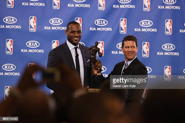 LeBron James of the Cleveland Cavaliers poses with Director of Marketing at Kia Motors America Tim Chaney and the trophy for the NBA 200809 Most...