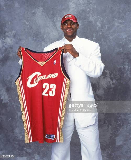 LeBron James of the Cleveland Cavaliers poses with his jersey during the 2003/2004 NBA Draft Portrait at Paramount Theatre Madison Square Garden on...