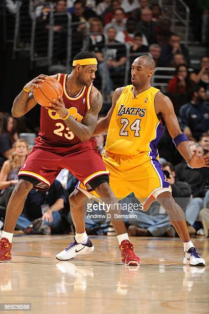 LeBron James of the Cleveland Cavaliers positions himself against Kobe Bryant of the Los Angeles Lakers on January 21 2010 at The Quicken Loans Arena...