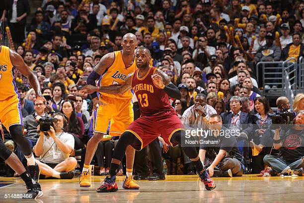 LeBron James of the Cleveland Cavaliers posts up against Kobe Bryant of the Los Angeles Lakers at STAPLES Center on March 10 2016 in Los Angeles...