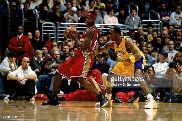 LeBron James of the Cleveland Cavaliers posts up against Kobe Bryant of the Los Angeles Lakers during a 2003 NBA game at the Staples Center in Los...