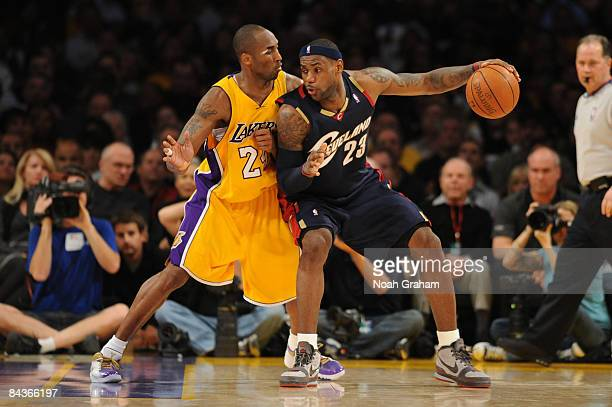 LeBron James of the Cleveland Cavaliers posts up against Kobe Bryant of the Los Angeles Lakers at Staples Center on January 19 2009 in Los Angeles...