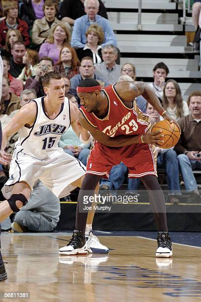 LeBron James of the Cleveland Cavaliers posts up against Matt Harpring of the Utah Jazz on January 21 2006 at the Delta Center in Salt Lake City Utah...