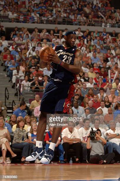 LeBron James of the Cleveland Cavaliers pulls down a rebound during a game against the Detroit Pistons in Game Five of the Eastern Conference Finals...
