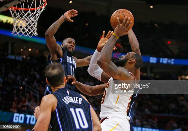 LeBron James of the Cleveland Cavaliers pulls up for a shot against Bismack Biyombo of the Orlando Magic at Quicken Loans Arena on January 18 2018 in...