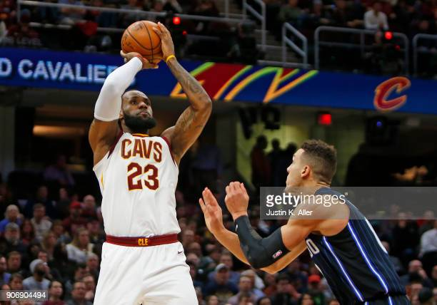 LeBron James of the Cleveland Cavaliers pulls up for a shot against Aaron Gordon of the Orlando Magic at Quicken Loans Arena on January 18 2018 in...