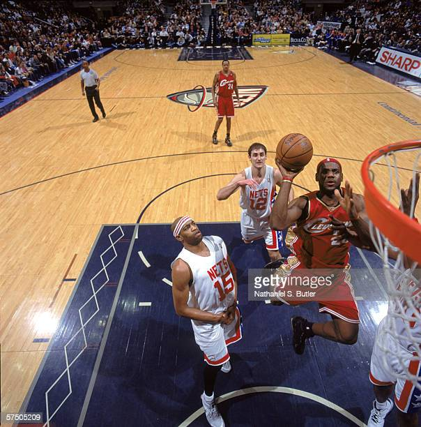 LeBron James of the Cleveland Cavaliers puts a shot up against the New Jersey Nets at Continental Airlines Arena in East Rutherford, New Jersey. The...