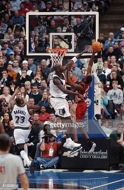 LeBron James of the Cleveland Cavaliers puts up a shot against Kevin Garnett of the Minnesota Timberwolves during the game at Target Center on...
