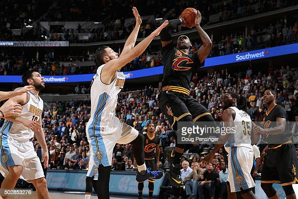 LeBron James of the Cleveland Cavaliers puts up a shot against Joffrey Lauvergne of the Denver Nuggets at Pepsi Center on December 29 2015 in Denver...