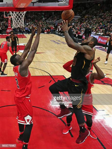 LeBron James of the Cleveland Cavaliers puts up a shot between Jerian Grant and David Nwaba of the Chicago Bulls at the United Center on March 17...