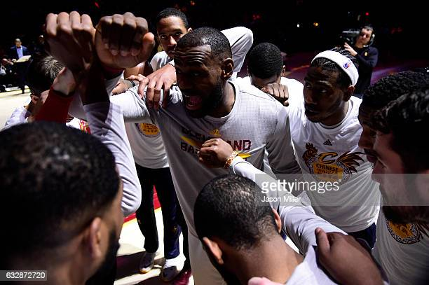 LeBron James of the Cleveland Cavaliers rallies his teammates during player introductions prior to the game against the Brooklyn Nets at Quicken...