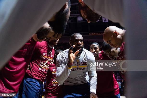 LeBron James of the Cleveland Cavaliers rallies his teammates in the huddle during player introductions prior to the game Golden State Warriors at...