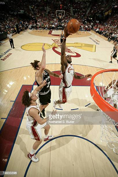 LeBron James of the Cleveland Cavaliers reaches for a rebound against the San Antonio Spurs in Game Four of the NBA Finals at the Quicken Loans Arena...