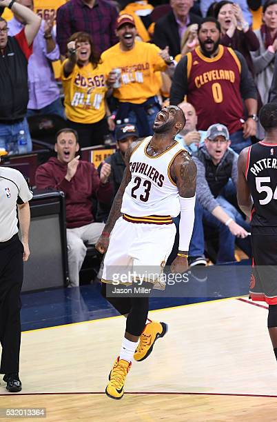 LeBron James of the Cleveland Cavaliers reacts after a basket in the second quarter against the Toronto Raptors in game one of the Eastern Conference...