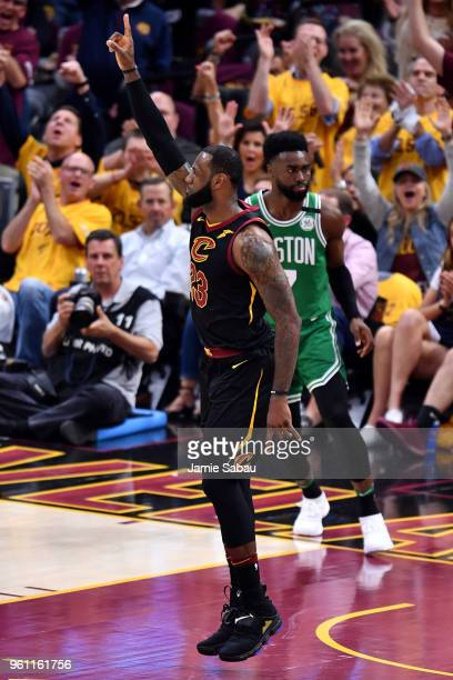 LeBron James of the Cleveland Cavaliers reacts after a basket in the first half against Jaylen Brown of the Boston Celtics during Game Four of the...