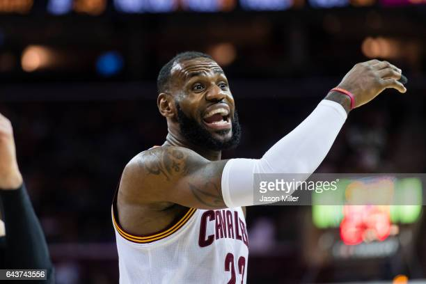 LeBron James of the Cleveland Cavaliers reacts after a call during the first half against the Milwaukee Bucks at Quicken Loans Arena on December 21...