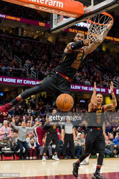 LeBron James of the Cleveland Cavaliers reacts after a dunk during the second half against the Washington Wizards at Quicken Loans Arena on February...