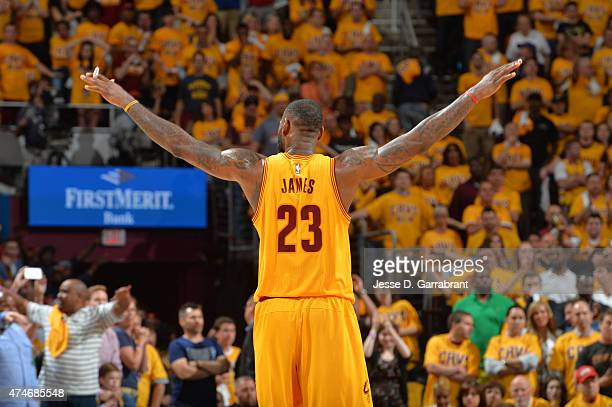 LeBron James of the Cleveland Cavaliers reacts after a play against the Atlanta Hawks at the Quicken Loans Arena During Game Three of the Eastern...