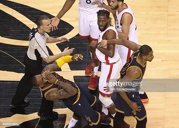 LeBron James of the Cleveland Cavaliers reacts after being hit in the face by teammate Tristan Thompson during the first half against the Toronto...