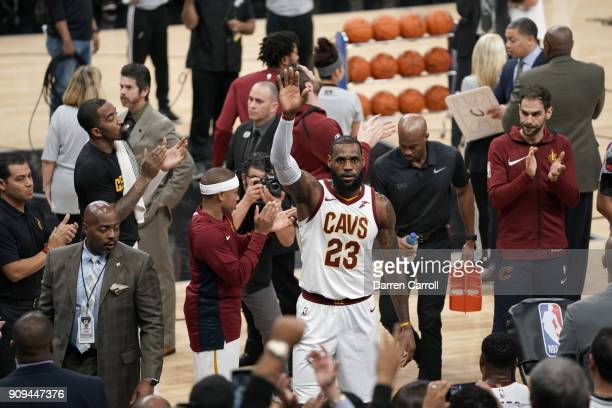 LeBron James of the Cleveland Cavaliers reacts after he scores his 30000th career point during the game against the San Antonio Spurs on January 23...