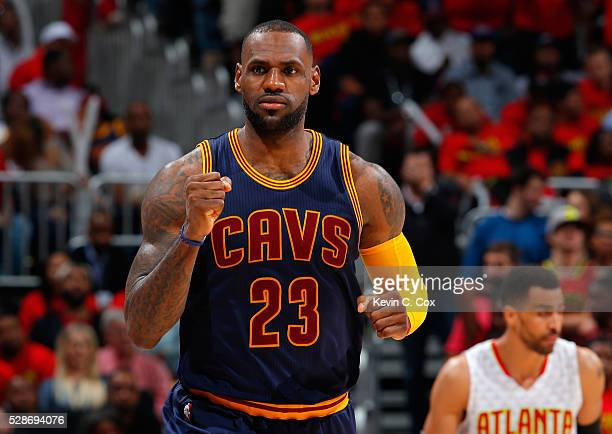 LeBron James of the Cleveland Cavaliers reacts after hitting a basket against the Atlanta Hawks in Game Three of the Eastern Conference Semifinals...