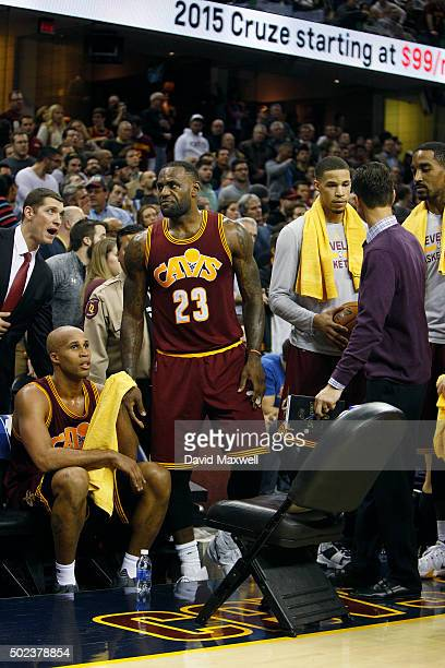 LeBron James of the Cleveland Cavaliers reacts after walking courtside during a timeout to check on Ellie Day wife of professional golfer Jason Day...
