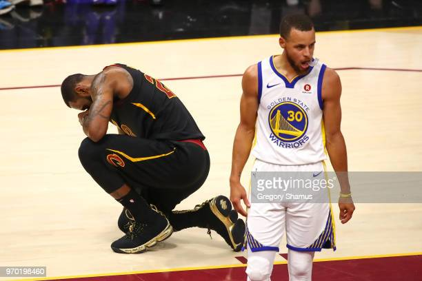 LeBron James of the Cleveland Cavaliers reacts against Stephen Curry of the Golden State Warriors during Game Four of the 2018 NBA Finals at Quicken...