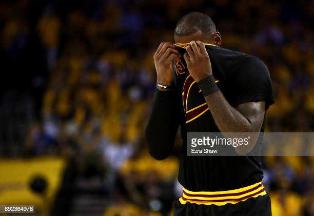 LeBron James of the Cleveland Cavaliers reacts against the Golden State Warriors during the second half in Game 2 of the 2017 NBA Finals at ORACLE...
