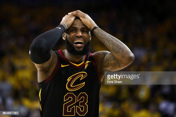 LeBron James of the Cleveland Cavaliers reacts against the Golden State Warriors in Game 1 of the 2018 NBA Finals at ORACLE Arena on May 31, 2018 in...