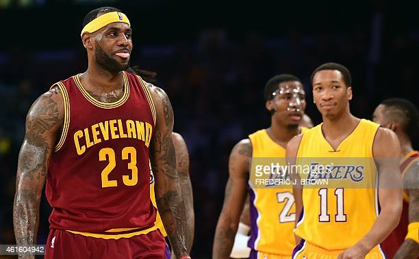 LeBron James of the Cleveland Cavaliers reacts as he takes to the court after a timeout in the second quarter against the Los Angeles Lakers during...