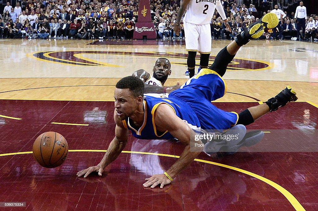 LeBron James #23 of the Cleveland Cavaliers reacts as Stephen Curry #30 of the Golden State Warriors falls during the first half in Game 4 of the 2016 NBA Finals at Quicken Loans Arena on June 10, 2016 in Cleveland, Ohio.