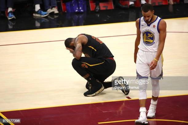 LeBron James of the Cleveland Cavaliers reacts as Stephen Curry of the Golden State Warriors looks on in the first half during Game Four of the 2018...